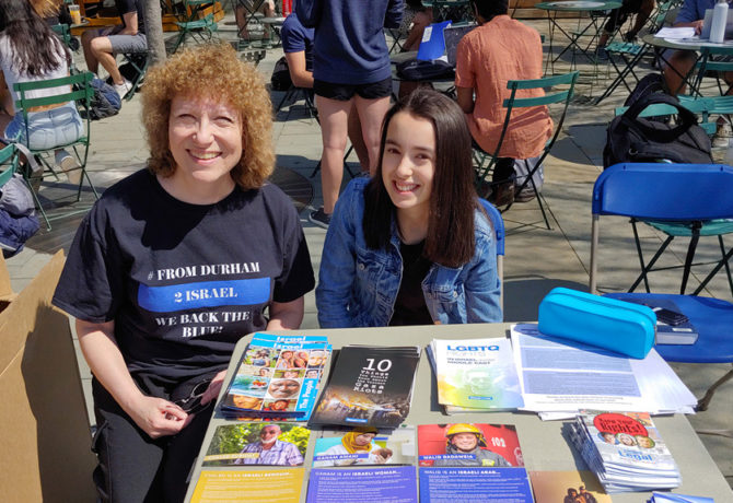 Amy Rosenthal with Duke supporters of Israel countering the nearby Israel Apartheid Week Display